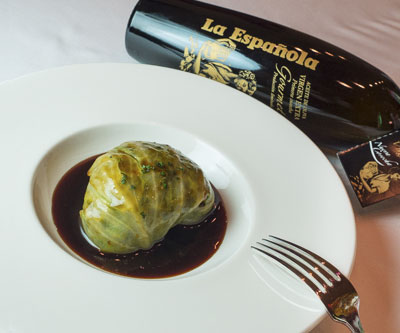 Cabbage stuffed with duck confit and vegetables